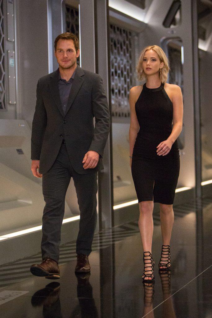 Jim (CHRIS PRATT) and Aurora (JENNIFER LAWRENCE) walk thru the Hibernation Bay on date night in Columbia Pictures' PASSENGERS.